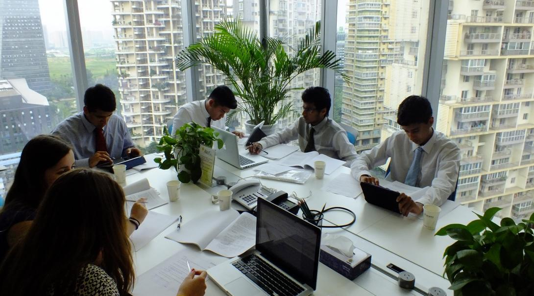 Projects Abroad Law interns attend a meeting run by experienced local lawyers at a firm as part of their Law internship in China.